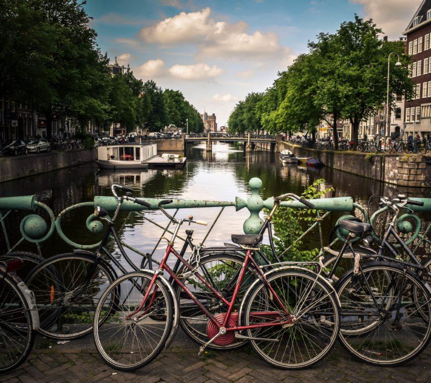 amsterdam niederlande holland fahrräder kanal sonnenschein stocksnap io